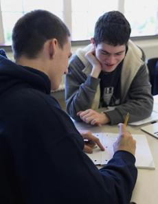 Seniors Davis Rochester (left) and Lucas Cassels worked on a problem during an advanced calculus class that integrates computer coding at Beaver Country Day School in Brookline.